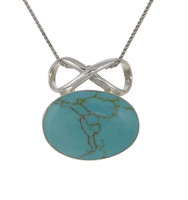 Sterling Silver and Formed Turquoise Oval and Bow Pendant
